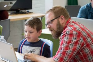 Financeit employee teaching child at CoderDojo