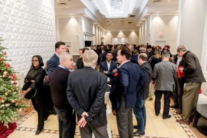 Crowd of people networking at WinDoor event
