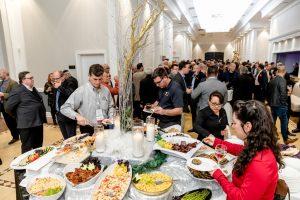 Crowd of people around food at WinDoor Event